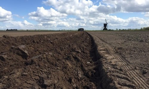 Ploughing to form a bank